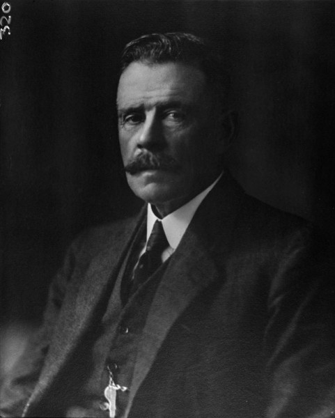 Studio portrait of middle aged man in three piece suit circa 1914.