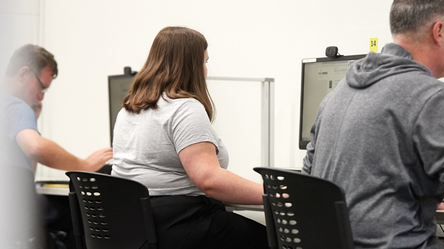 Men and woman working at computers